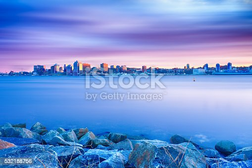 A beautiful long exposure image of the Halifax, Nova Scotia skyline at sunset.