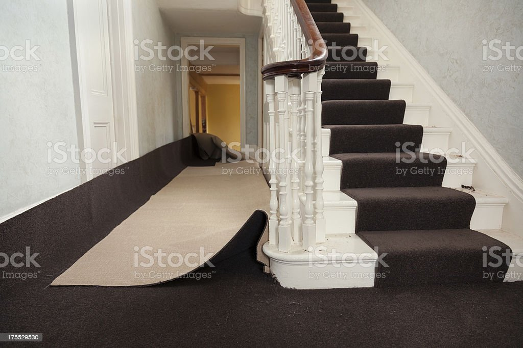 Hall carpet being fitted stock photo