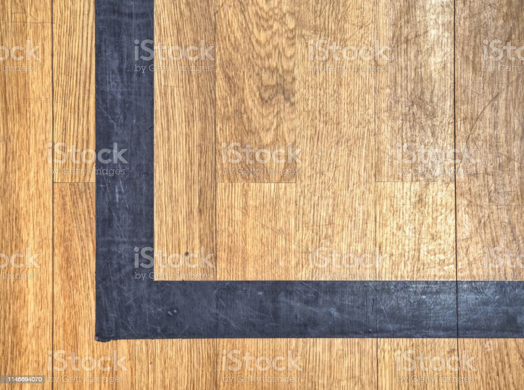 Hall floor in a gymnasium with diverse lines. Worn out wooden floor...