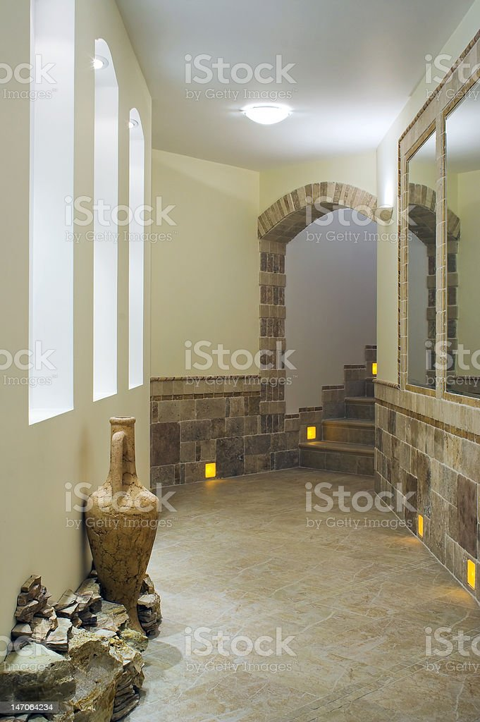 Hall interior with staircase, niches and mirrors royalty-free stock photo