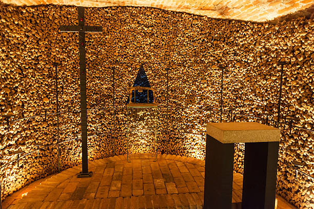 Hall with cross in Ossuary of St James Church Brno Brno, Czech Republic - September 25, 2015: Hall with cross in Ossuary of St James Church on Jakubske square in Brno. it was a big collection of bones estimated to have belonged to in excess of 50000 people brno stock pictures, royalty-free photos & images