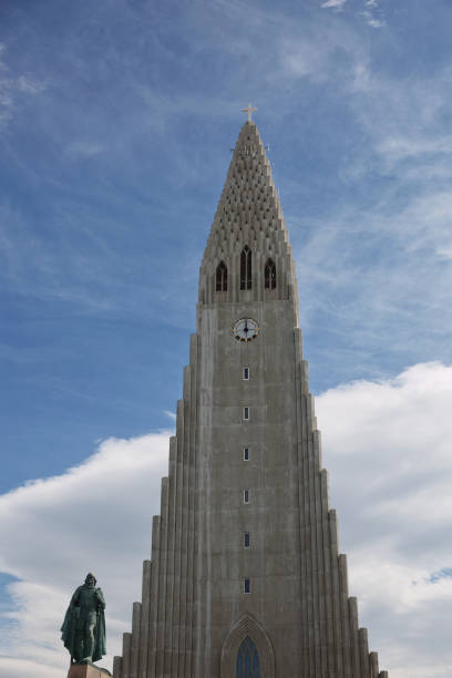 Hallgrimskirkja Cathedral in Reykjavik, Iceland, lutheran parish church, exterior in a sunny summer day with a blue cloudy sky Reykjavik, Iceland - July 29, 2017: Hallgrimskirkja Cathedral in Reykjavik, Iceland, lutheran parish church, exterior in a sunny summer day with a blue cloudy sky. Hallgrímskirkja church stock pictures, royalty-free photos & images