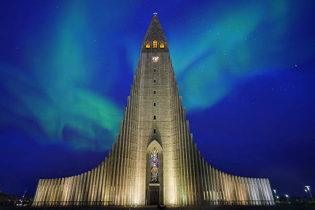 Hallgrimskirkja with Northern Light Hallgrimskirkja with Northern Light Hallgrímskirkja church stock pictures, royalty-free photos & images