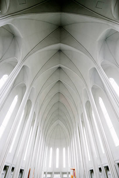 Hallgrímskirkja, Lutheran Cathedral Church of Raykjavik, interior, ceiling Hallgrímskirkja, Lutheran Cathedral Church of Raykjavik, interior view of the contemporary architecture. View of the interior ceiling, nobody, vertical composition.  Hallgrímskirkja church stock pictures, royalty-free photos & images