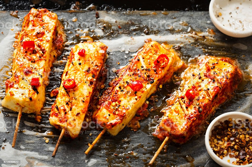 Halloumi cheese barbecue skewer with chilli stock photo
