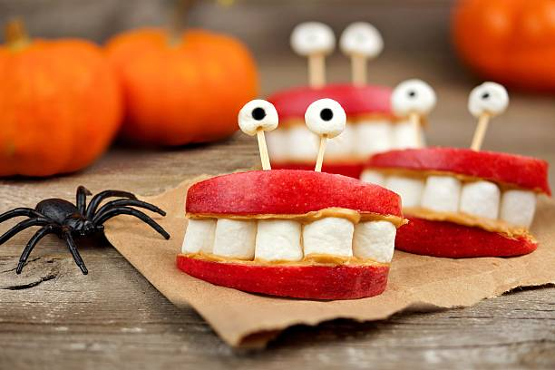 Halloween apple marshmallow peanut butter monster teeth over wood picture id587782474?b=1&k=6&m=587782474&s=612x612&w=0&h=b0dd7o2zp4cbyyi0osl4ccd6yyli xzuptm5osd qyk=