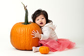 Halloween baby girl with pumpkins