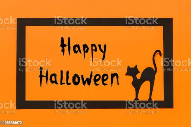 Halloween background black paper cat text happy halloween in black picture id1036568672?b=1&k=6&m=1036568672&s=612x612&h=ko ge qifxogsnjkk1clpamlfyi2bhkiqdma6eyq7fe=