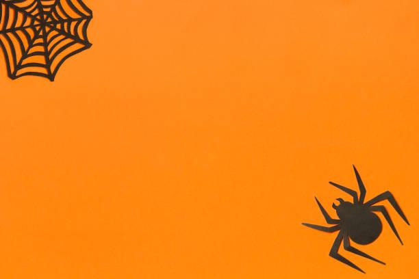 Halloween background black paper spider and spiderweb on orange picture id1026393734?b=1&k=6&m=1026393734&s=612x612&w=0&h=ejpnjf7bsqywojbnznpgdhsum02y6c9uih6a3fhc8ke=