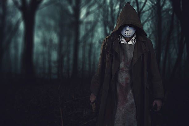 halloween background - bloody serial killer in the scary woods - killer stock photos and pictures