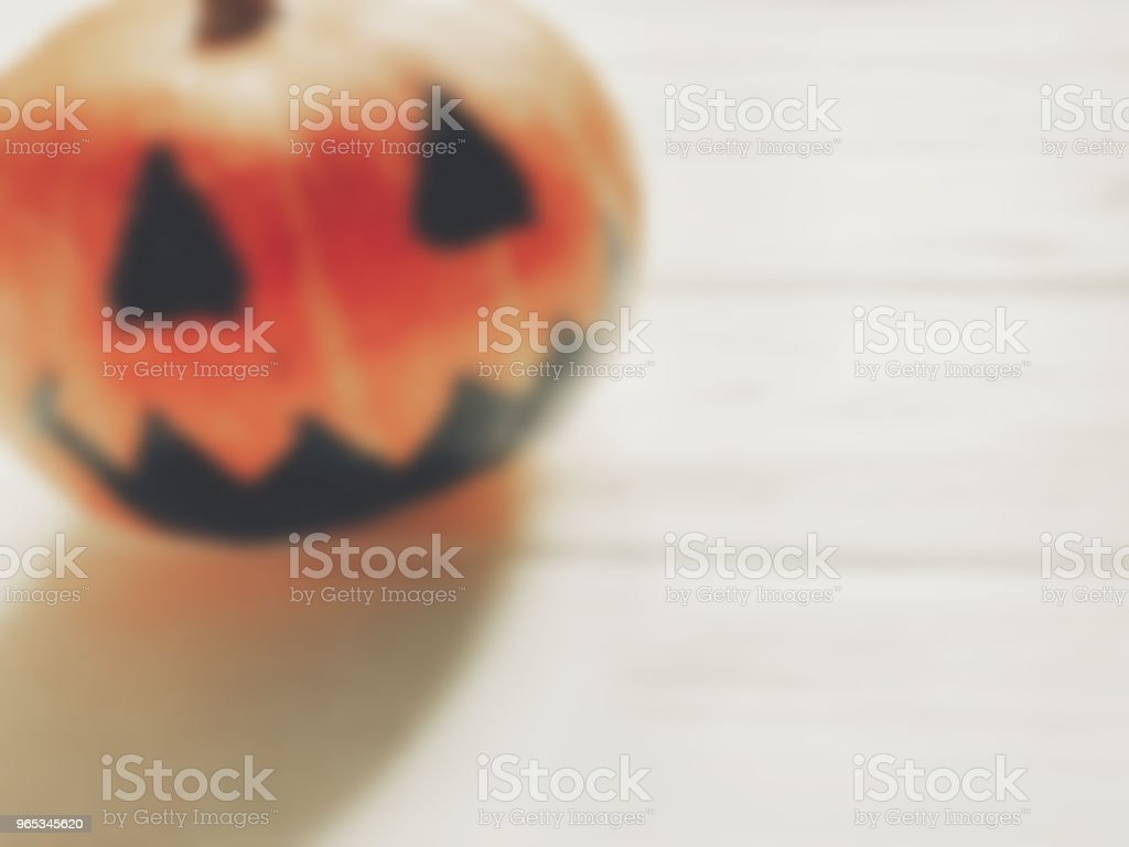 halloween background. blurred spooky jack lantern pumpkin with on wood. holiday celebration. seasonal greetings. happy halloween concept, space for text royalty-free stock photo