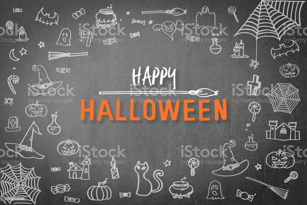 Halloween background for happy halloween holiday greeting festival celebration with chalk doodle on spooky dark black chalkboard with drawing of pumpkin, spider web, witch hat, trick or treat candies stock photo