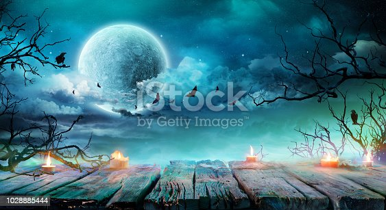 Halloween Background  - Wooden Table With Candles At Spooky Night With Full Moon