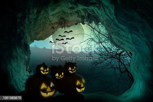 istock Halloween background. Spooky pumpkin with moon and dead trees on dark forest. Halloween design concept with copy space. 1051563570