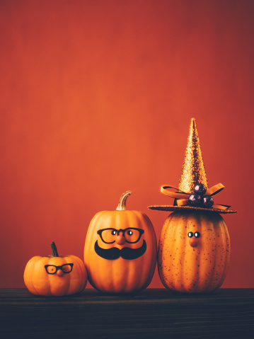Halloween background with cute pumpkin character family