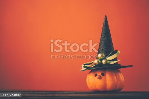 istock Halloween background with cute pumpkin witch 1171754892