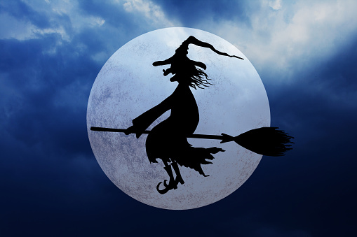 istock Halloween background with full moon and flying witch 1048094200
