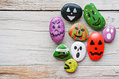 Halloween background with funny painted stones