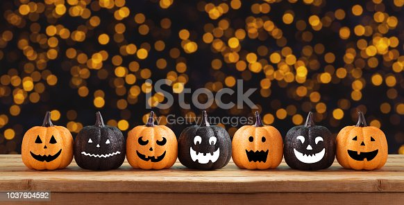 istock Halloween background with glitter pumpkin characters decor 1037604592