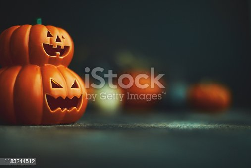 Halloween background with Jack O'Lantern and pumpkins