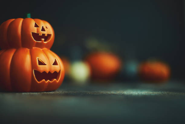 halloween background with jack o'lantern and pumpkins - happy halloween zdjęcia i obrazy z banku zdjęć