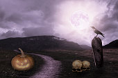 Apocalyptic Halloween scenery with pumpkin, grave, raven skull and moon