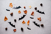 istock Halloween background with paper bats decorations 1169810192