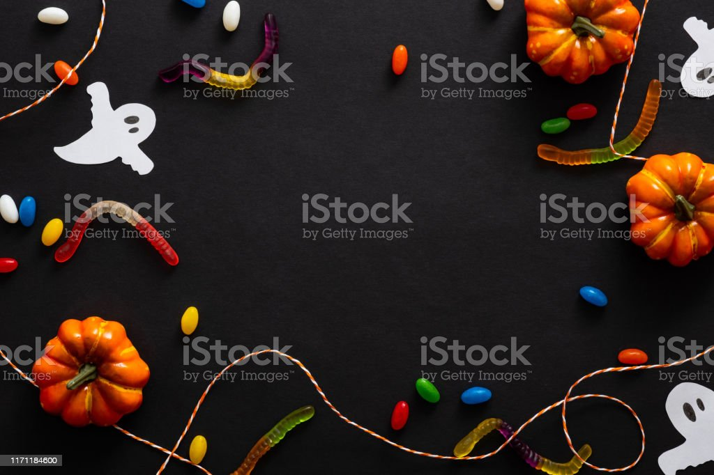 Halloween Background With Pumpkins Candy Rope Ghosts Isolated On Black Halloween Party Invitation Card Mockup Flat Lay Top View Copy Space Stock Photo