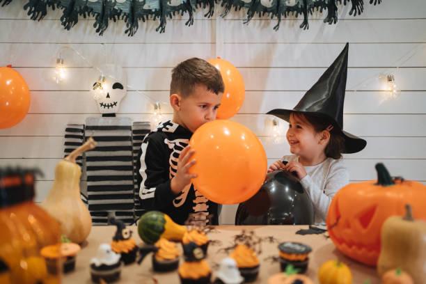Halloween balloon blowing stock photo
