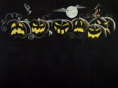 Halloween night scene on blackboard.