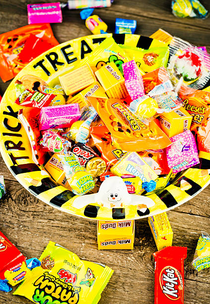 halloween candies in trick or treat bowl - kit kat stock photos and pictures
