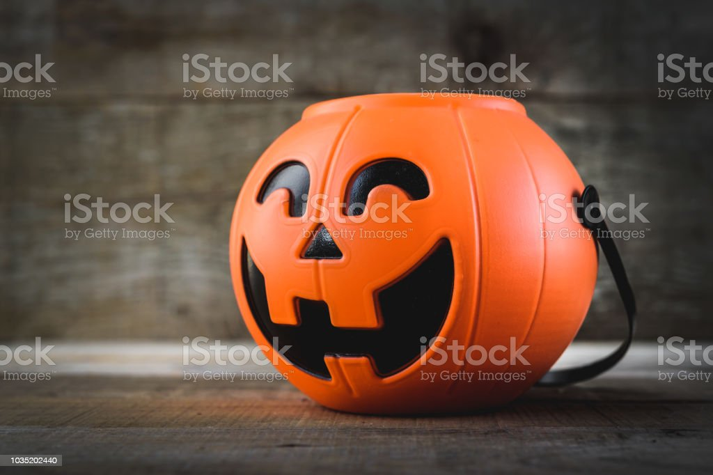 Halloween candies on wood table - holiday background stock photo