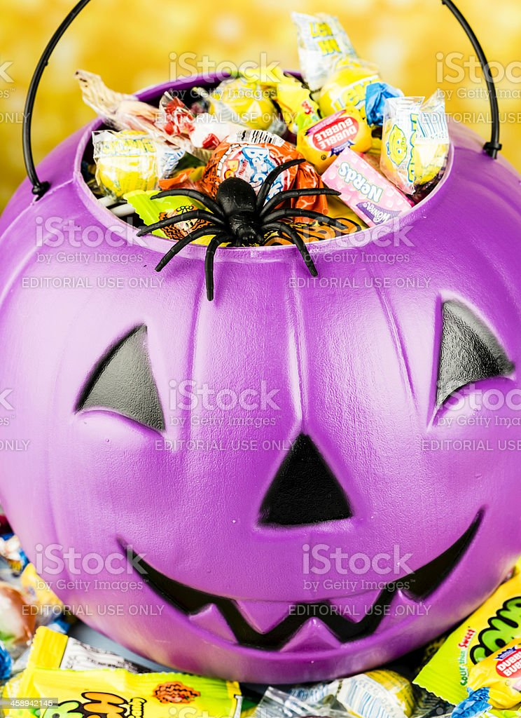 Halloween Candy and Pumpkin Head Bucket with Spider stock photo