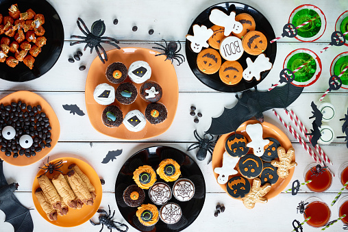 High angle view of various decorated treats for Halloween celebration