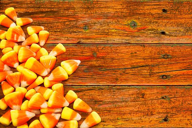 Halloween Candy Corn On Rustic Orange Wood Stock Photo