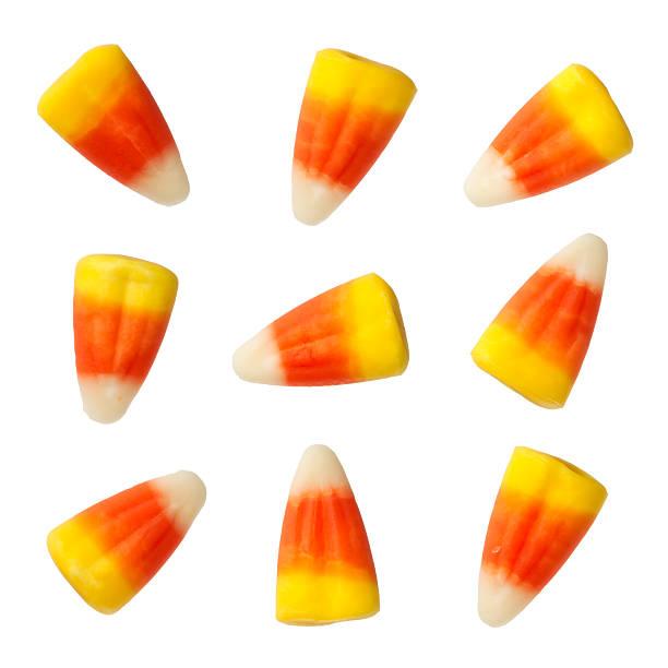 конфеты на хеллоуин corns изолированные на белом фоне - halloween candy стоковые фото и изображения