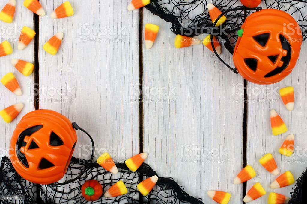 Halloween candy frame on white wood stock photo