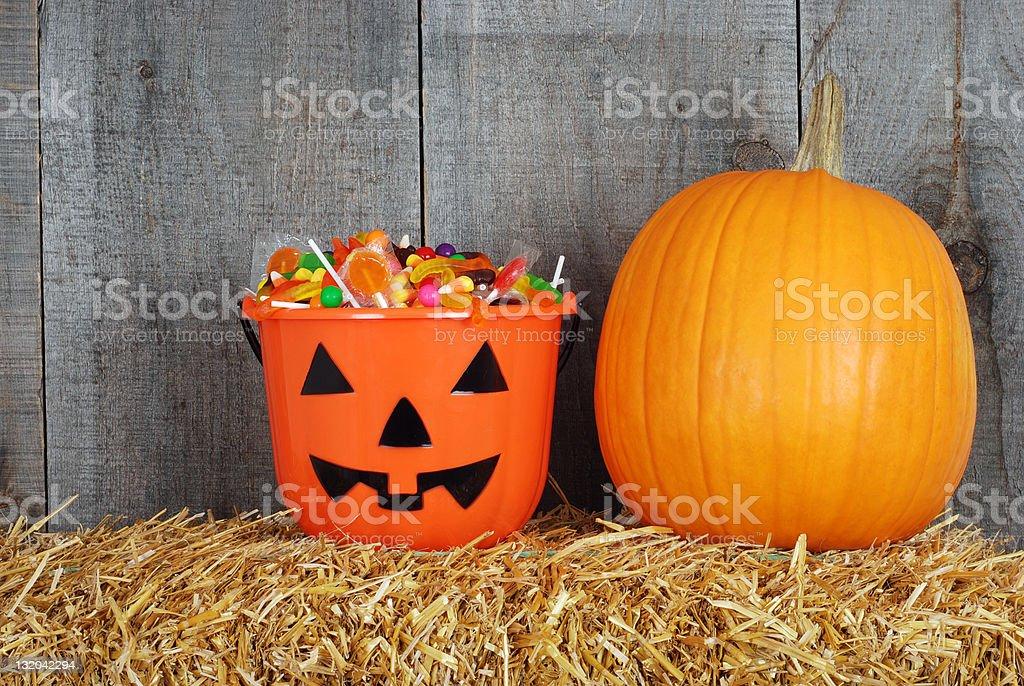 Halloween candy in pumpkin bucket royalty-free stock photo