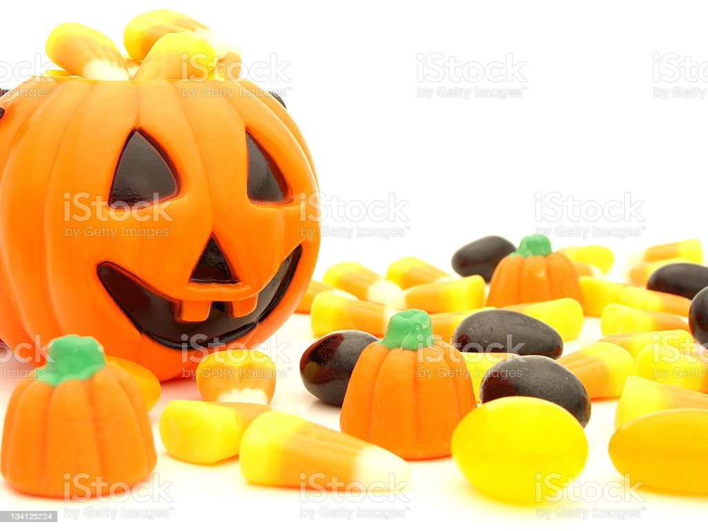 halloween candy with jack o lantern holder over white stock photo