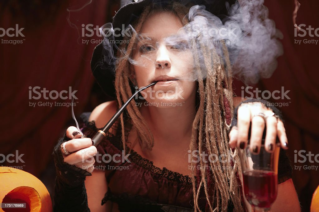 Halloween casino. Witch with smoking pipe. royalty-free stock photo