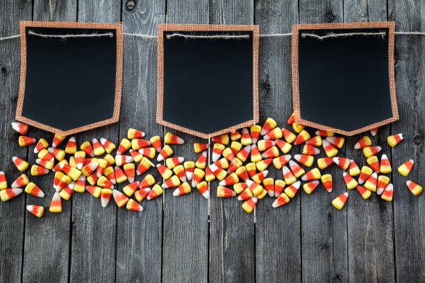 Halloween Celebration Concept With Candy Corn And Black Mockups stock photo