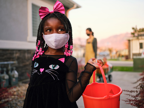 Halloween Children Trick Or Treating Wearing Facemasks Stock Photo - Download Image Now