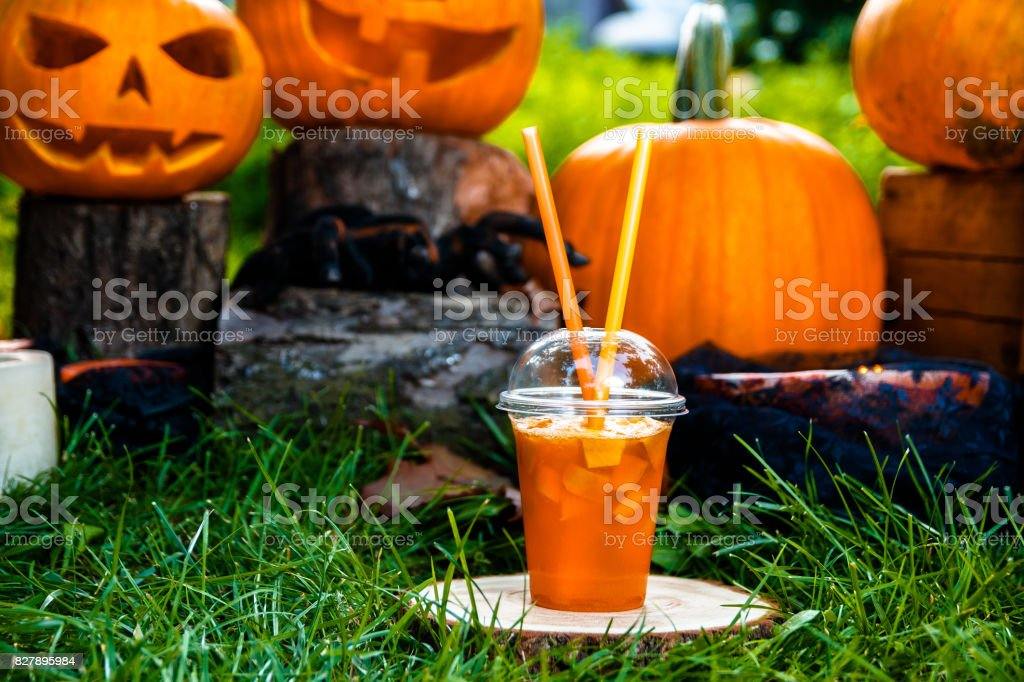 Halloween cocktail with pumpkins decoration on background. Punch for a party. Jack-o-Lantern. stock photo