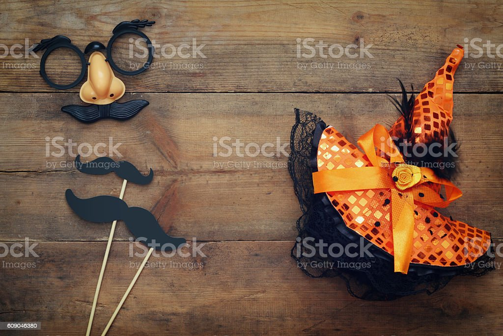 Halloween concept. Funny mustache mask and witch hat stock photo
