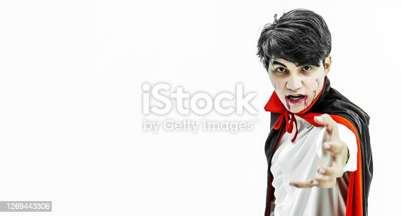 Halloween concept of young asian man dressed up as Dracula for the halloween party, isolated on white.