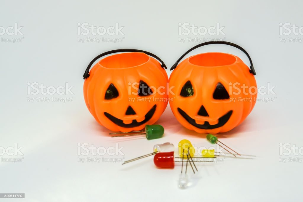 Halloween concept - pumpkin of Jack-O-Lantern with colorful light bulbs stock photo