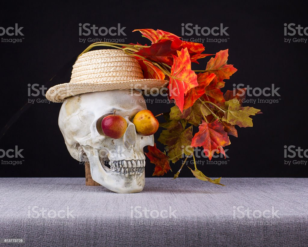 Halloween concept. The skull smelling and watching  with apple eyes stock photo