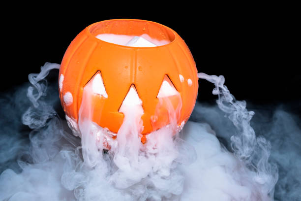 halloween concept with pumpkin lantern smoky the effect of dry ice on darkness background stock photo more pictures of abstract istock