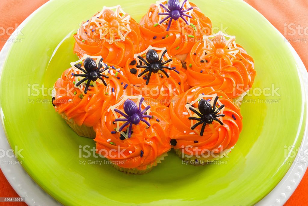 Halloween cupcakes decorated with toy plastic spiders royalty-free stock photo