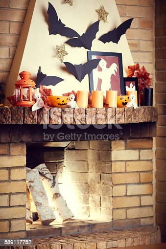 istock Halloween decor with brick fireplace and spooky decoration 589117752